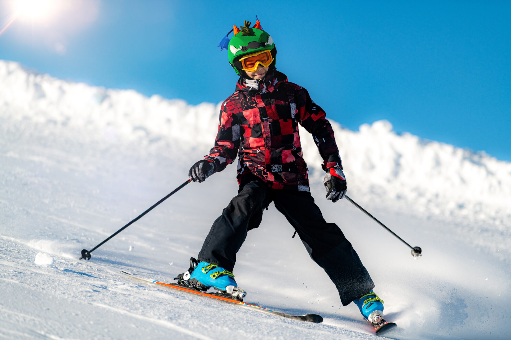 Portrait of boy skier on the mountain